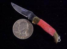 Jaguar folding knife red handles-1